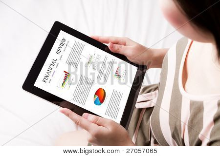 Woman reading financial review on the touch screen device
