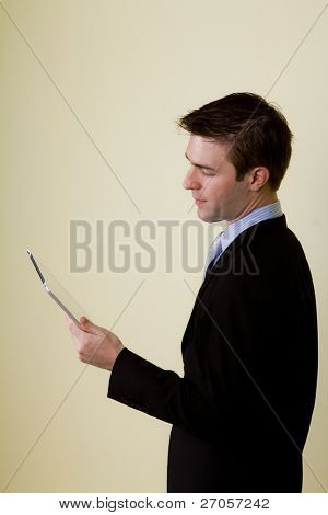 Portrait of  young business man using a touch screen device
