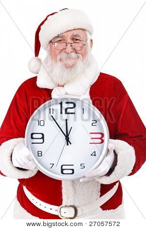 Santa Claus with real beard holding clock, clock showing five minutes to midnight, isolated on white background