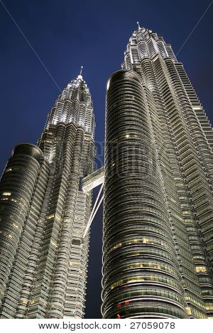 vertical view of the petronas towers at dusk,Kuala Lumpur, Malaysia