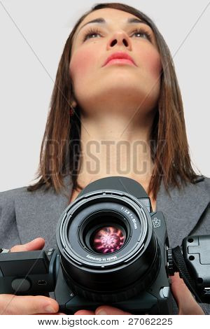 Woman in suit holding a Medium format Camera