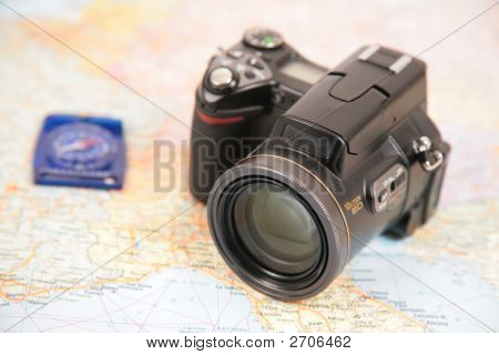 Camera And Compass On Map Of Europe