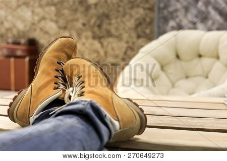 Male Feet With Orange Shoes
