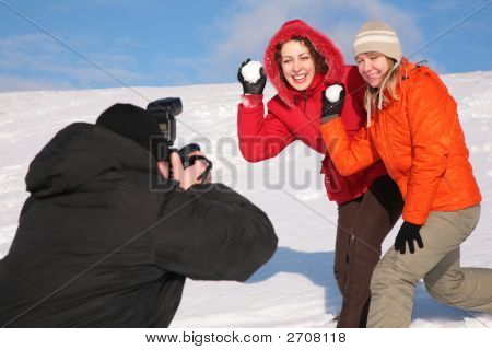 Two Girls Throw Snows Into Photographer