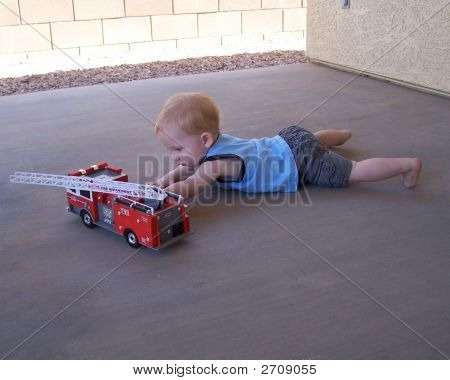 Boy Playing With Fire Truck