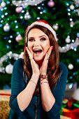 Surprised Happy Woman At Christmas. Woman At Christmas. Christmas Surprise. poster