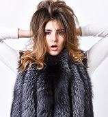 Girl Makeup Face Long Hairstyle Wear Fur Vest White Background. Fashion Trend Winter Clothes. Luxury poster