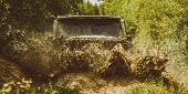Off Road Sport Truck Between Mountains Landscape. Offroad Vehicle Coming Out Of A Mud Hole Hazard. D poster