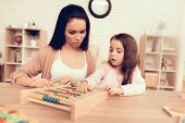 Woman Teaches Girl. Educational Games. Learning Child At Home. Cubes And Puzzles. Child Development. poster