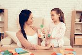 Mother Teaches Daughter. Woman And Girl Play. Educational Games. Learning Child At Home. House Of Cu poster