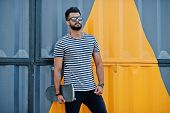 Handsome Tall Arabian Beard Man Model At Stripped Shirt Posed Outdoor. Fashionable Arab Guy At Sungl poster