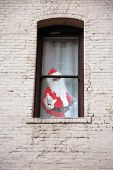 Santa Claus. Santa Claus in a window. Santa is kidnapped and held ransom in an old abandoned buildin poster