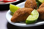 Fried kibble with lemon, Quibe poster