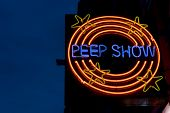 foto of brothel  - Lighted sign peepshow against a night sky in Amsterdam - JPG