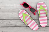 Modern Flip Flops Sandals With Pink Sunglasses On A Wooden Floor. 3d Rendering poster