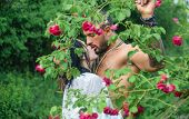 Spring Lovers In Blooming Garden. Lovely Spring Couple Kiss And Hugs. Summer Couple And Erotic Momen poster