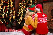 Couple In Love, Man Male Husband And Woman Female Wife In Santa Elf Hats And Warm Red Sweaters Huggi poster