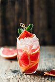 Fresh Grapefruit Cocktail. Fresh Summer Cocktail With Grapefruit And Ice Cubes. Glass Of Grapefruit  poster
