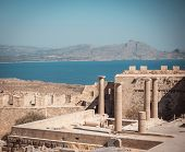 View On Several Pillars Of Lindos Acropolis On Rhodes poster
