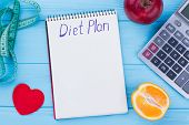 Low-calorie Fruit Diet. Fruits, Measuring Tape, Calculator And Paper Notebook. Diet Plan Concept. poster