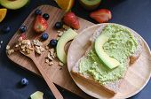 Fresh Avocado Cream Or Guacamole On Baguette Slices, Raw And Healthy Food For Veganview And Copy Spa poster