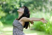 stock photo of teenage girl  - happy teenage girl breathing in wild nature - JPG