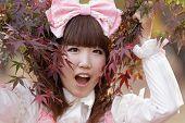 foto of lolita  - japanese girl in sweet lolita cosplay style in red fall maple - JPG