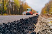 Laying A New Asphalt On The Road. Worker Operating Asphalt Paver Machine During Road Construction. C poster