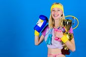 Sport Shop Assortment. Girl Successful Modern Woman Hold Golden Goblet Of Sport Champion And Equipme poster