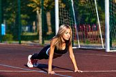 Sport Girl. The Girl Is Doing Fitness Exercises. Beautiful Young Sports Woman Doing Exercises. A Gir poster