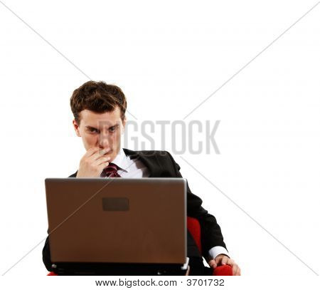 Young Confident Man With Laptop
