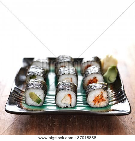 vegetarian sushi rolls with carrot, crab and avacado.