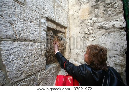 JERUSALEM - JANUARY 02: Via Dolorosa, 5th Stations of the Cross. The pilgrims who visit the Holy Land, pass the path that Jesus carried the cross to Calvary. Jerusalem on January 02, 2008.