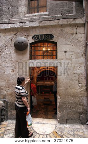 JERUSALEM - OCTOBER 03: Via Dolorosa, 7th Stations of the Cross. The pilgrims who visit the Holy Land, pass the path that Jesus carried the cross to Calvary. Jerusalem on October 03, 2006.