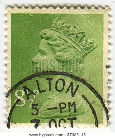 UK-CIRCA 1960:A stamp printed in UK shows image of Elizabeth II is the constitutional monarch of 16 sovereign states known as the Commonwealth realms, in green, circa 1960.