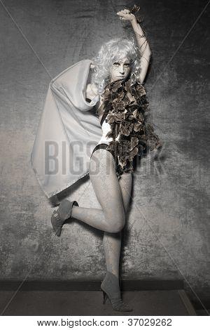 attractive woman in exotic costume. indoor shot