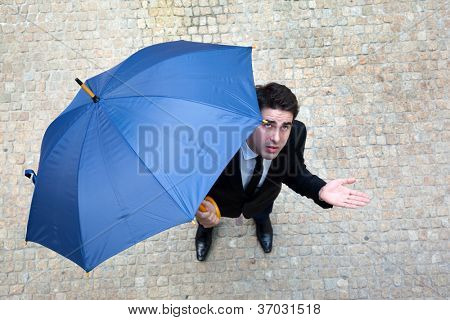 Young business man checking if it's raining