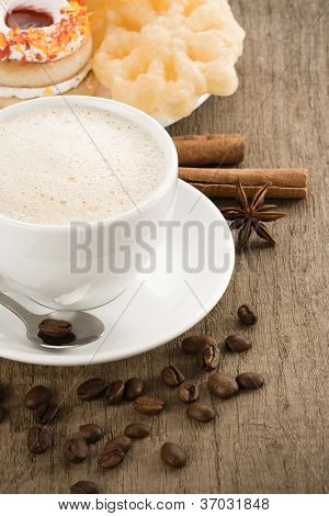coffee cappuccino and sweets on wooden table