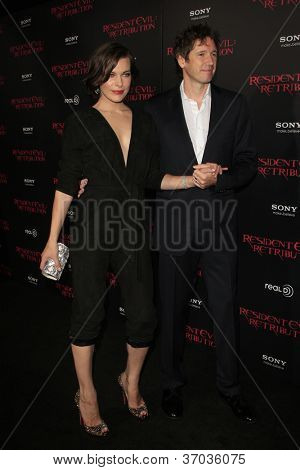 LOS ANGELES - SEP 12:  Milla Jovovich, Paul W.S. Anderson arrives at the