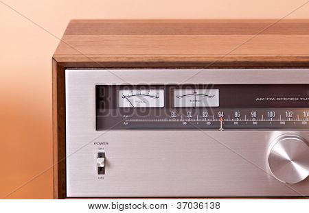 Vintage hi-fi Stereo Tuner in wooden cabinet, front