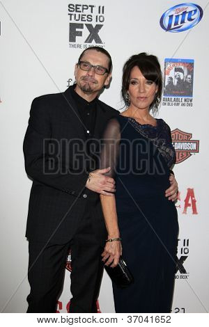 "LOS ANGELES - SEP 8:  Kurt Sutter, Katey Sagal arrives at the ""Sons of Anarchy"" Season 5 Premiere Screening at Village Theater on September 8, 2012 in Westwood, CA"