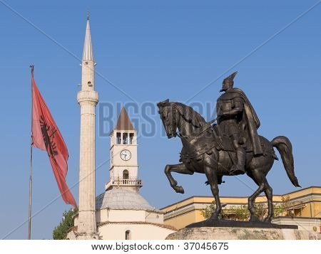 Statue of Skanderbeg (national hero of the Albanians), Ethem Bey mosque and the Clock Tower in Skanderbeg Square, Tirana