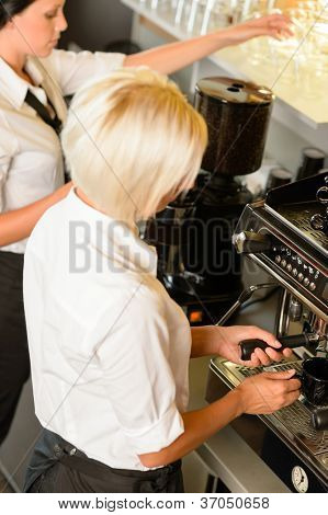 Waitresses at work make coffee machine cafe  woman espresso machine