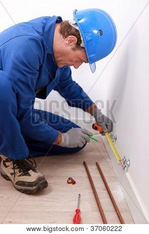 Craftsman taking measures