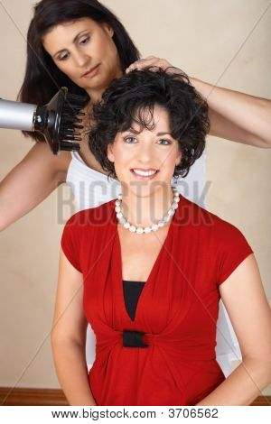 Hairdresser Working On Happy Woman