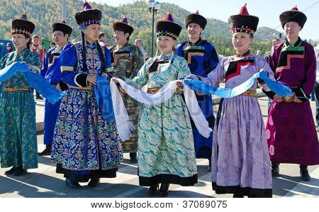 ULAN-UDE, RUSSIA - SEPTEMBER 15: Cultural program of Baltic Economic Forum. An unidentified womans in national dress Buryat greets guests of festival , September 15, 2012 in Ulan-Ude, Buryatia, Russia