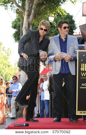 LOS ANGELES - SEP 17: Jay DeMarcus, JoeDon Rooney at a ceremony where the band Rascal Flatts receive a star on the Hollywood Walk of Fame on September 17, 2012 in Los Angeles, California