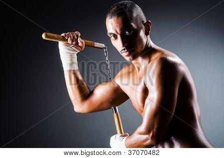 Strong man with nunchaku