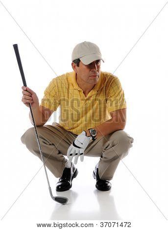 Hispanic mature golfer holding patter isolated over white background