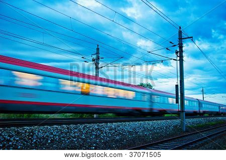 a passenger train travels through the night. night train with people of ���¶bb